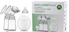 مضخة حليب كهربائية مزدوجة امنة للارضاع مع زجاجات لحفظ الحليب