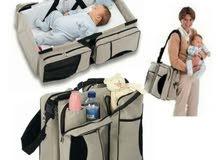 الان سرير وشنطة للطفل2في1 و6جيوب فيها متنقلة وعملية