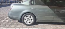 نيسان ألتيما خضراء اللون 2006
