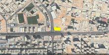 ارض تجاريه على شارع الشيخ خليفه تصريح ارضى و 18 تملك حر بموقع مميز