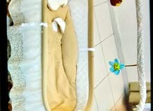Baby cot with swing and timer
