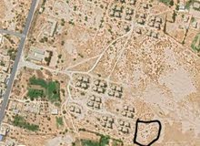 قطعة ارض للبيع بي صبراتة منطقة بير التوتة النهضة خلف الوحدة السكنية