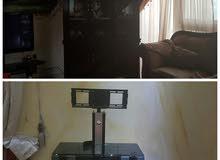 طاولة تلفاز و مكتبة زجاج