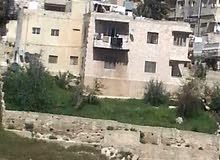 بنايه طابقين في جبل الحسين