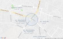 مجمع تجاري مكون من 7 شقق و سوبر ماركت و مطعم في منطقه الرجيب خلف شركه مرسيدس