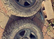 Jeep Wrangler rim with mountain tires
