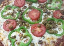 معلم بيتزا و معجنات