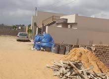 أرض عين زارة الكحيلي شارع مقابل 300 متر بها قواعد وكاتينة للبيع على نقال 0915399