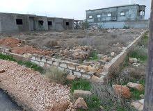 قطعة ارض فى بنغازى منطقة بوصنيب 1000 متر على شارعين شارع قطران والاخر ترابى