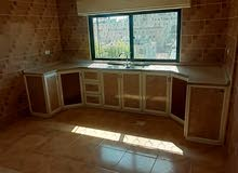 شقة غير مفروشه للايجار  مكونه من غرفتين نوم +غرفة صالة+غرفة ضيوف+حمامين ومطبخ
