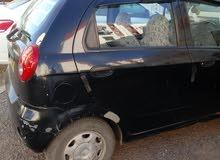 سيارة سبارك سودائ اللون 2007 نضيفة محرك هايل ماشية 260000 مفيهاش السبيغة