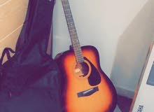 Yamaha acoustic guitar with the bag
