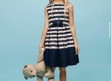 فستان من ماركة كارولينا هريرا جديد المقاس صغير مقاس 8 سنوات يلبس 7 سنوات