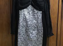 فستان سهرة تحت الركبة