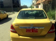 Nissan Versa 2009 For sale - Yellow color