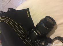كاميرا نيكون مع طابعه لطباعه الصور كانون