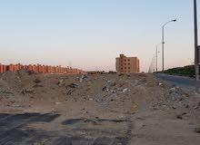 قطعة ارض طريق الواحات جوار جامعة نوال الدبيكي دبل فيس
