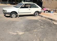 Mazda 323 1988 - Tripoli