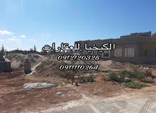 الكيخيا للعقارات بنغازي  قطعة ارض للبيع في القوارشه-شارع جامعه البريطانيه