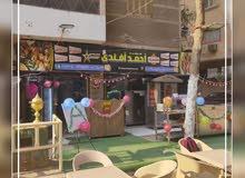 مطعم للبيع علي شارع كبير بعين شمس مرخص وحصة بالارض - ناصية 5 ابواب - واجهه 7.5 متر