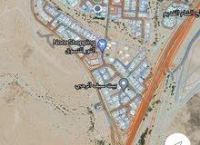 أرض في فلج الشام بموقع مميز أول قطعة من الشارع الرئيسي
