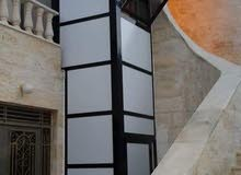 مصعد كهربائي خارجي دون تأسيس