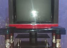 ميز تلفزيزن مع التلفيزون علما ان التلفزيون يوجد فيه عطل  السعر 60 الف + بلي2 ما