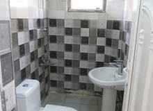 للايجار شقة ارضية حديثة معزولة في الكرادة خارج ب750 الف