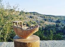 ثمثال خشبي لسفينة عمانية من خشب العتم