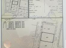 للبيع ارض سكنية على شارعين من الامام و الخلف في الانصب الثانية