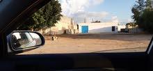 مبنى وساحة لاغراض ( معرض سيارات_ مخزن او للاغراض التجارية او الصناعية )