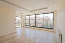 شقة ارضي  مساحة 170م2 مع ترس 60م2 تقريبا بموقع مميز في تلاع العلي بتشطيبات فندقية