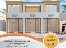 مبني محلات للبيع في عجمان الزاهية علي شارع 40 متر اتجاهين قار متفرع من شارع الشيخ محمد بن زايد
