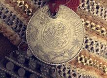 برقع يعود ل عام 1354 هـ والآخر ل عام 1327هـ وعقد فضه نادر