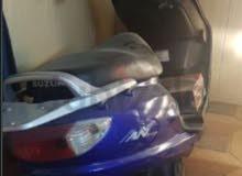 للبيع سوزوكي 125cc مع رقم أبوظبي 918