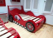 سرير اطفال بشكل سيارة عمل يمني