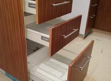 مطبخ مصنوع من كونتر واخد طبقة ملامين واخر واخد طبقة فورميكا الاثنين ضد المياه وا