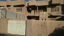 بيت تجاري 200 م للبيع  الامين الثانيه قرب محطة البانزين على الشارع العام