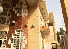 بيت في الناصرية حي الشموخ للبيع 250م وجه 12.5م 7 غرف نوم 3حمام مرمر طابقين
