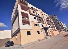 شقة نص تشطيب للبيع خلف جامعة ناصر