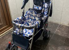 عربة اطفال توم
