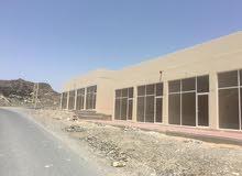 **(OK) للبيع مبنى تجارى بمصفوت عجمان بسعر 650 الف درهم