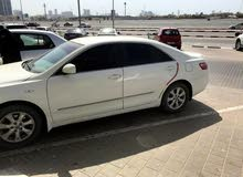 Toyota camry gulf specification in a good condition for sale due to travelling.