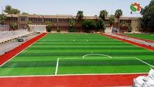 تجهيز ارضيات ملاعب كرة قدم بالعشب الصناعي