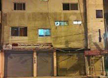 بيت للبيع مقابل سوبر ديلكس  مركز الاستقلال مكون من ثلاث طوابق +رووف