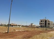 أرض مميزة للبيع في منطقة الطنيب حوض العيادات بجانب جامعة الإسراء على طريق المطار