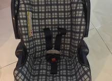 car seat from Graco and straw basket for baby