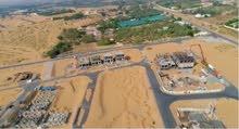 تملك أرض سكنية متكاملة حيث الخدمات ,, بافضل المواقع في عجمان - على شارع الشيخ محمد بن زايد  KBH 01