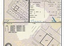 فرصة لبناء توين فيلا ع شارع قار في العامرات 6/1- المالك