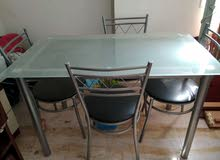 4 Seater Glass Dining Table in Perfect Condition For Sale 50 Riyals Last Price